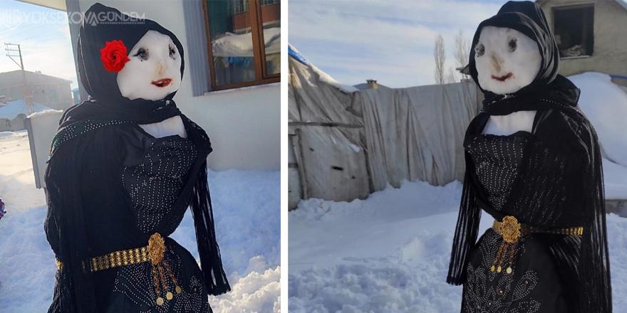 Yüksekova'da Kardan kadına yöresel elbise fistan giydirdiler